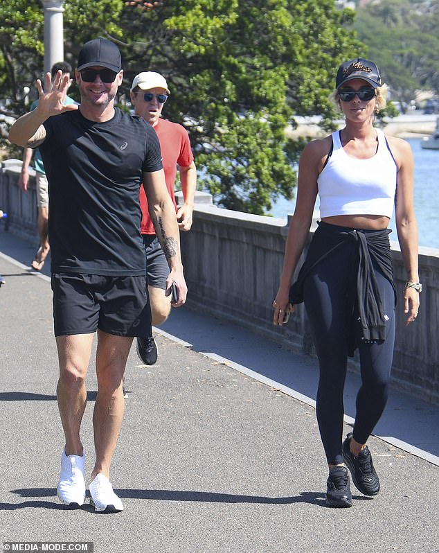 Looking fit: Michael showcased his muscular frame in black shorts and a matching T-shirt