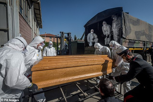 Masked personnel transport a coffin to an army truck in Ponte San Pietro, near the city of Bergamo, where the local morgue and crematorium were swept away