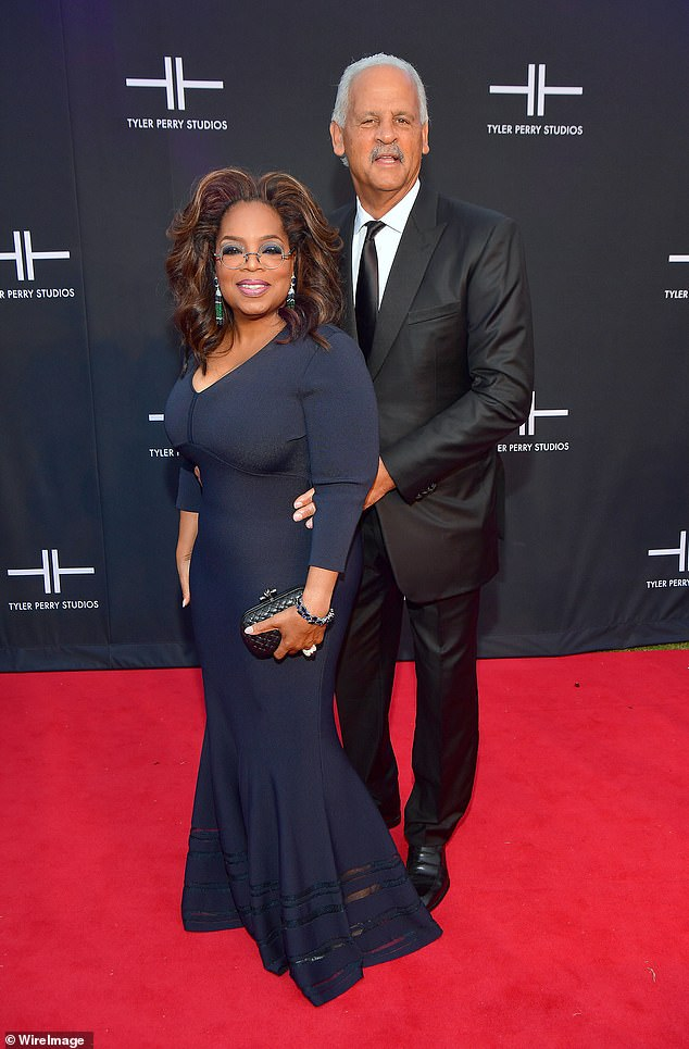 Her love: Oprah Winfrey has revealed she is sleeping in separate houses to her long-time partner Stedman Graham amid concerns over coronavirus (pictured in October)
