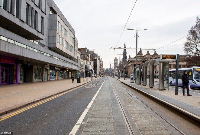 An empty Princes Street in Edinburgh - one of the city's main shopping routes - this morning as the UK goes into lockdown