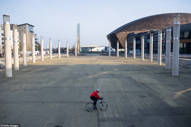A lone cyclist in the Roald Dahl Plass public plaza in Cardiff this morning after the lockdown measures were brought in