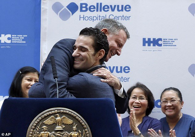 Experience: Dr. Spencertreated ebola patients in West Africa, and survived the virus himself (pictured with Mayor Bill de Blasio after being released from the hospital in November 2014)