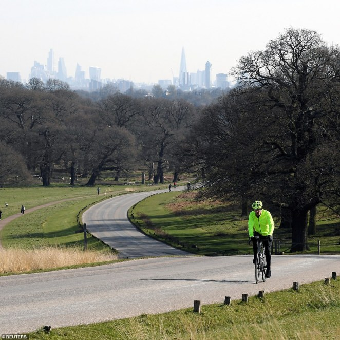 Today: Richmond Park is much quieter, with a single cyclist riding along an empty stretch of tarmac on the first day of lockdown