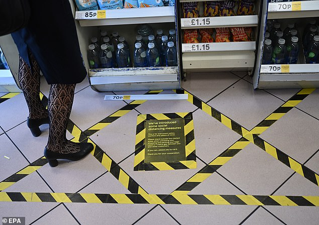 Tesco has laid down tape in many of its branches to keep customers at a two-metre gap in queues