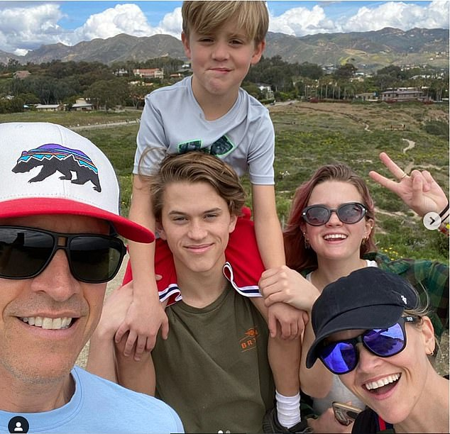Stay home! Lots of Los Angelenos are trying to cure their cabin fever by going on walks and hikes, like Reese Witherspoon and her family (pictured), but the mayor has closed city parks and trails