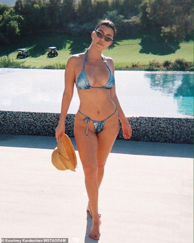 Hot mama: Kourtney Kardashian set pulses racing on Tuesday when she shared a series of throwback bikini photos