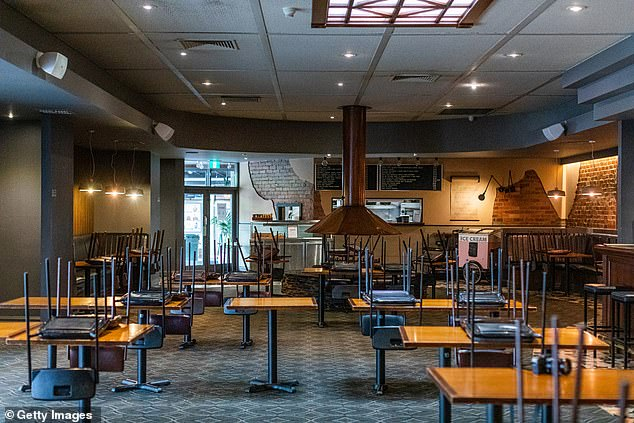 Since Monday, dine-in restaurants and cafes, pubs and clubs and gyms have been ordered to close in a bid to contain the spread of coronavirus. Pictured is an empty bistro in Melbourne's Notting Hill