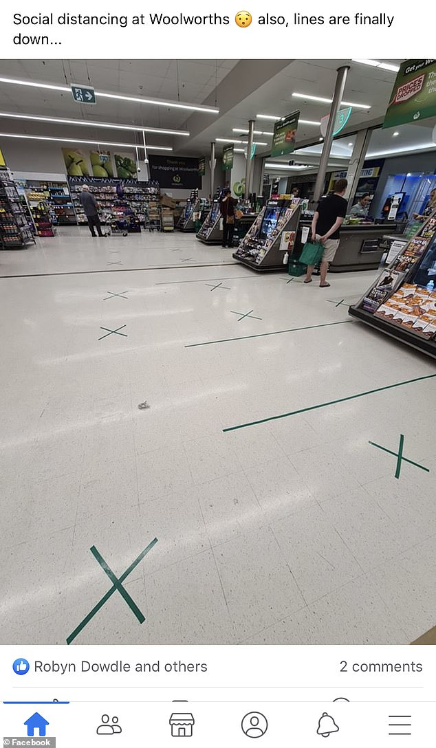 New floor markings at Woolworths Mount Gravatt  in Brisbane show how far shoppers should keep apart when waiting to be served at the checkouts