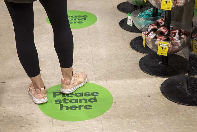 Floor markings are being rolled out across the country. Pictured is Sydney CBD's Town Hall store on Monday