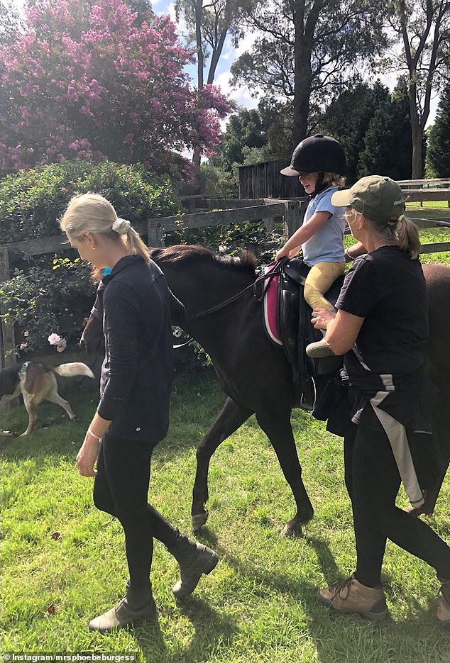 'Poppy's first ride': Phoebe also gave her daughter a chance to ride one of the family's horses on the property