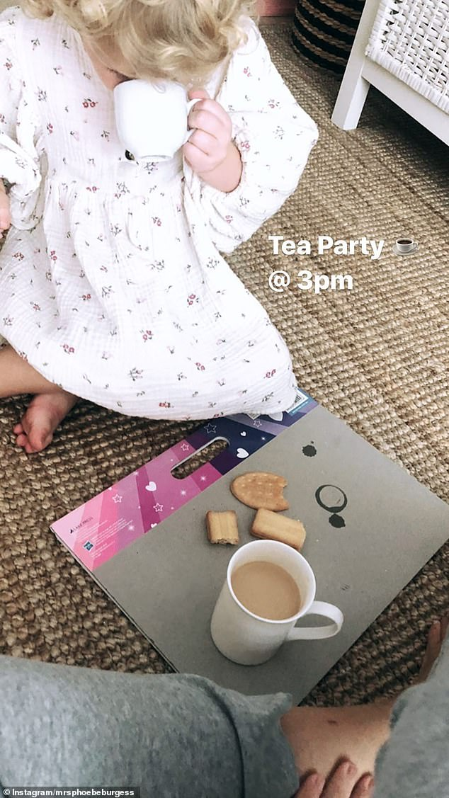 Mother-daughter time: The doting mother enjoyed a tea party with her little girl