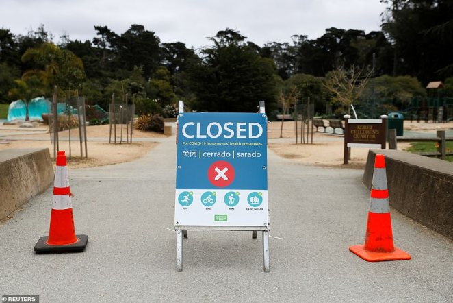 A sign announcing the closure of the Koret Playground is seen in Golden Gate Park as California continues its statewide 'stay at home order' to curb the public from loitering outside and potentially spreading COVID-19