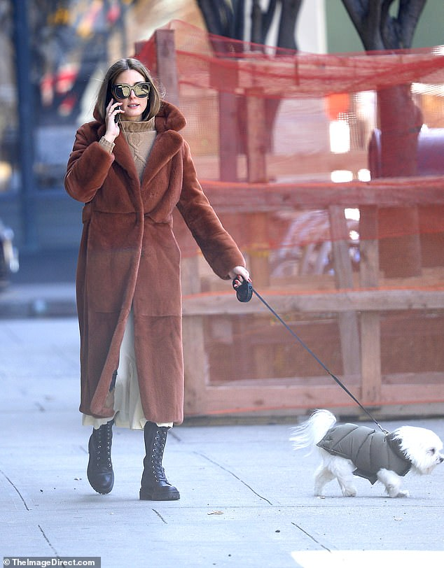 Olivia Palermo made sure not to sacrifice one iota of elegance while walking her dog through empty New York City streets on Tuesday