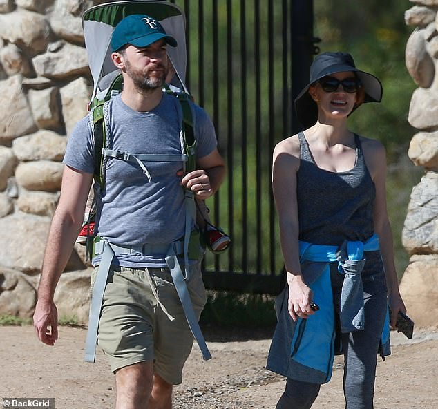 Jes' look:Chastain was seen wearing a grey tank top and matching grey sweat pants with a grey and blue jacket tied around her waist