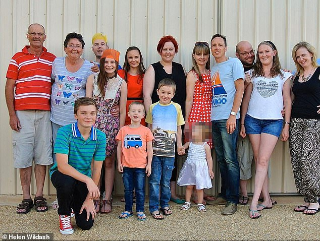 Proud grandparents: The Olds pictured with their daughters, son-in-laws, and grandchildren in a group shot in 2015