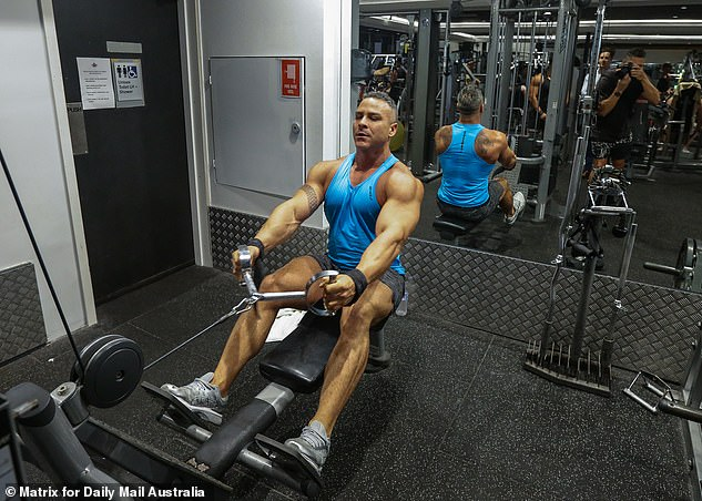 Fitness fanatics like Glen Armener (pictured) rushed into gyms for one final workout before the lockdown comes into play across the nation at midday on Monday