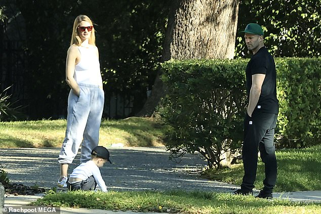 Play time:The couple were seen getting some fresh air with their son as their home city remains on lockdown