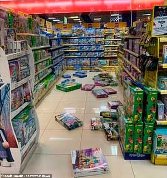Products fell off the shelves at this shop after a 7.5-magnitude earthquake which prompted some people to flee to safety