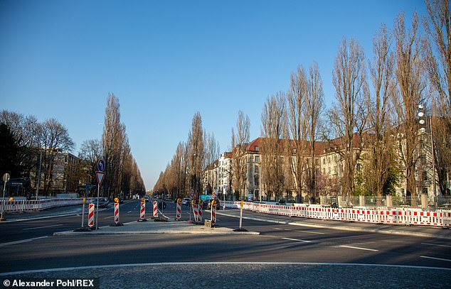 Barricades on a deserted street in Munich yesterday. The German government is planning to relax its usually strict fiscal policies to tackle the crisis