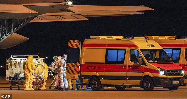 Germany is accepting coronavirus patients from nearby Italy, some of whom arrived at Leipzig/Halle airport early on Tuesday morning (pictured)