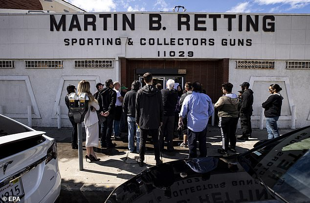 Buyers are purchasing guns and ammunition in the event they have to defend themselves from people who become desperate and unpredictable over the deadly flu-like virus, say retailers. Customers are pictured outside the Martin B. Retting guns store in Culver City, California