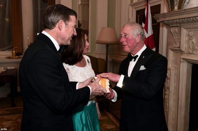 The Prince of Wales (right) talks to the Lord Mayor of London, William Russell, and his wife Hilary at a dinner for the Australian bushfire relief at Mansion House in London on March 12