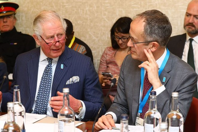 The Prince of Wales alongside Tim Wainwright from WaterAid at Kings Place on March 10