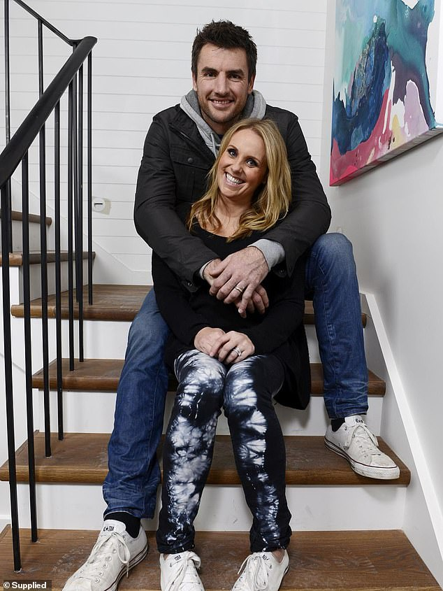 Sad split: Darren Jolly claims he hasn't been in contact with his two daughters 'for months' after splitting from his wife, Deanne, in September. Pictured together on The Block