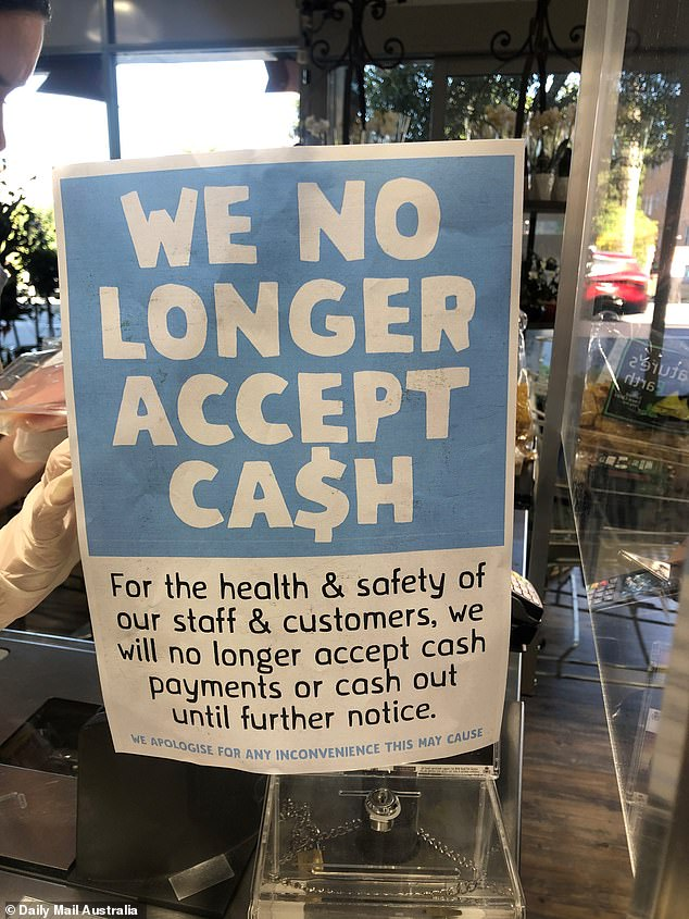 A Harris Farm Store is seen showing a sign saying cash will no longer be accepted