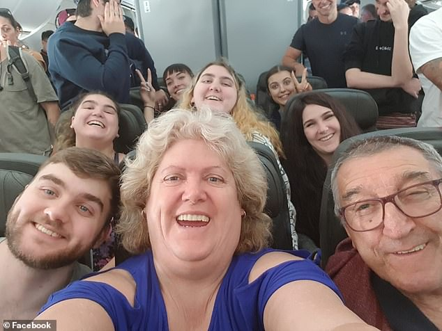 The whole family took many holidays together including this one where they all sat together on a plane