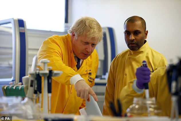 Boris Johnson visits a laboratory at the Public Health England National Infection Service in Colindale, North London, on March 1