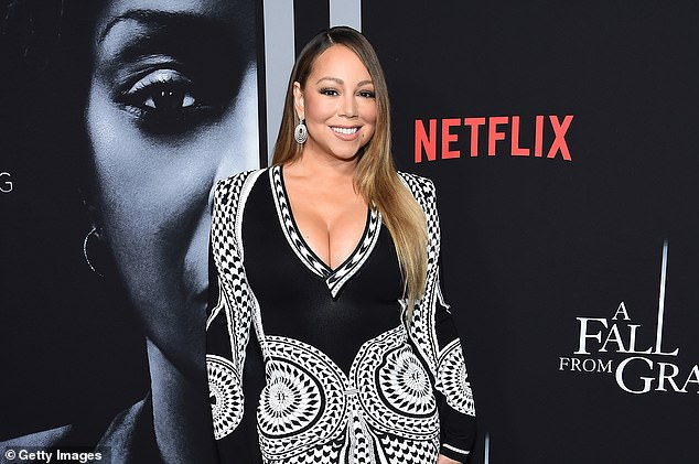 Missing the party:Carey is sadly unable to celebrate her momentous birthday with a bash, but she nonetheless got fans very excited by revealing she's working on new music