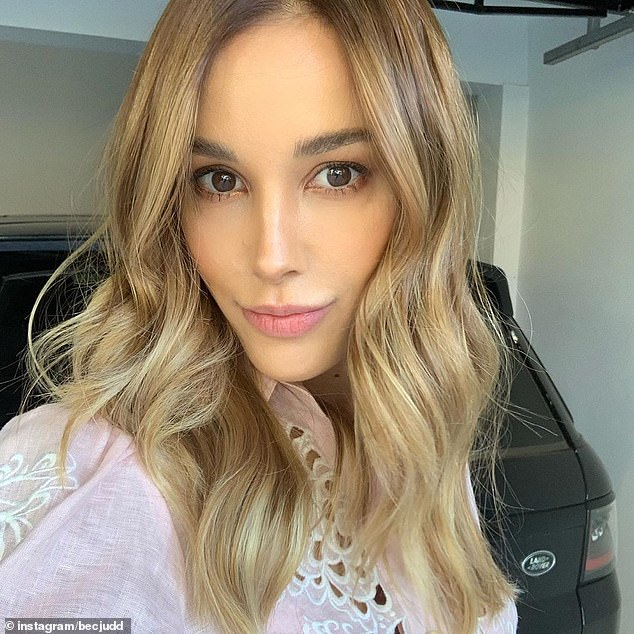 'Isodate with the gang!' On Friday, Rebecca Judd (pictured)enjoyed a group video chat and sing-along with celebrity friends including Nadia Bartel, Jessie Murphy and Hamish Blake while in lockdown amid the coronavirus pandemic