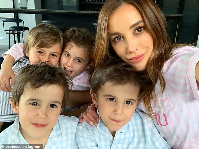 Her clan: On Monday meanwhile, Rebecca revealed she started homeschooling her children (pictured). Victorian schools shut down on Tuesday amid growing fears that children could spread coronavirus to older, more vulnerable Australians