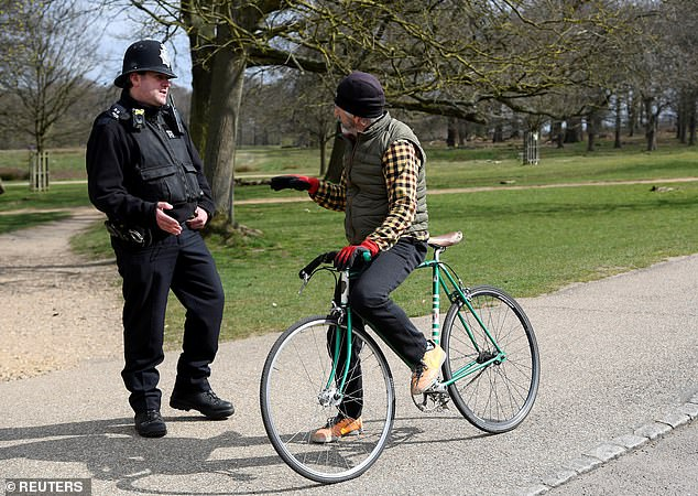 Police, pictured today speaking to a cyclist in London's Richmond Park, are at the heart of the Government's efforts to ensure social distancing works for everyone