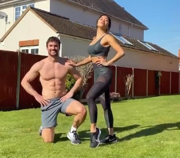 THE EXERCISE FACTOR: Talent show judge Nicole Scherzinger and her hunky rugby player boyfriend Thom Evans work out in the garden