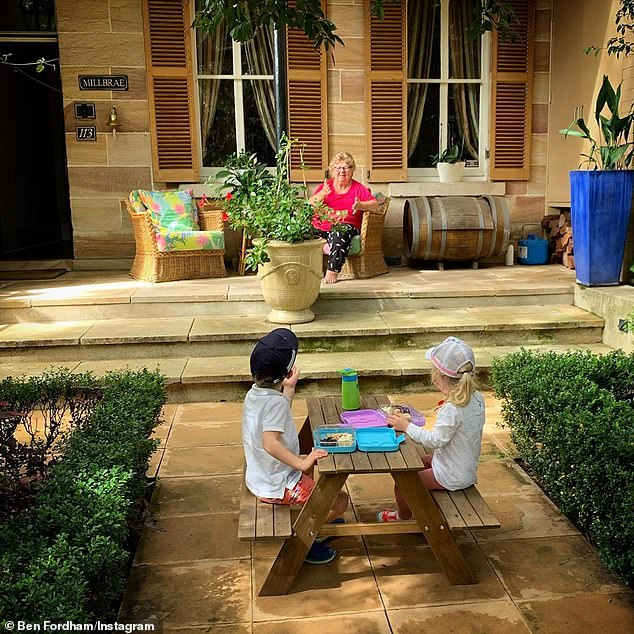 Social distancing: Ben's mother (pictured) smiled while she sat on a chair on the verandah, a safe distance away from Freddy (left) and Pearl (right)