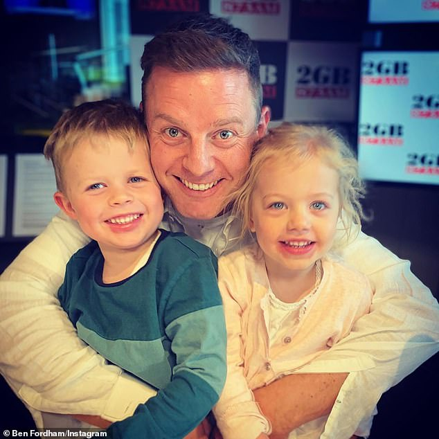 'BYO table and lunch': Ben Fordham shared cute-but-heartbreaking photo of his kids blowing kisses to their grandmother as they ate at separate tables to maintain distance amid COVID-19. Pictured: Ben Fordham with two of his children Freddy (left), five, and Pearl (right), three