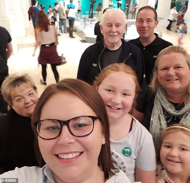 Susan Nelson (far left) with her family. Her daughter Amanda and father Robert, a retired electrical engineer, are still battling the killer bug but are 'showing improvement'