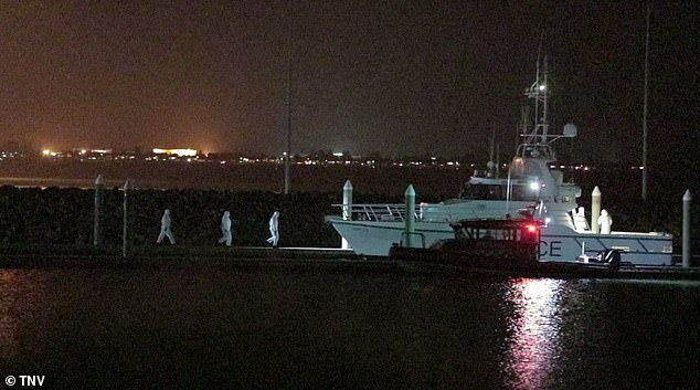 The 'several' affected crew members were brought ashore in the hours-long operation by a police vessel at Botany Bay south of Sydney on Sunday night
