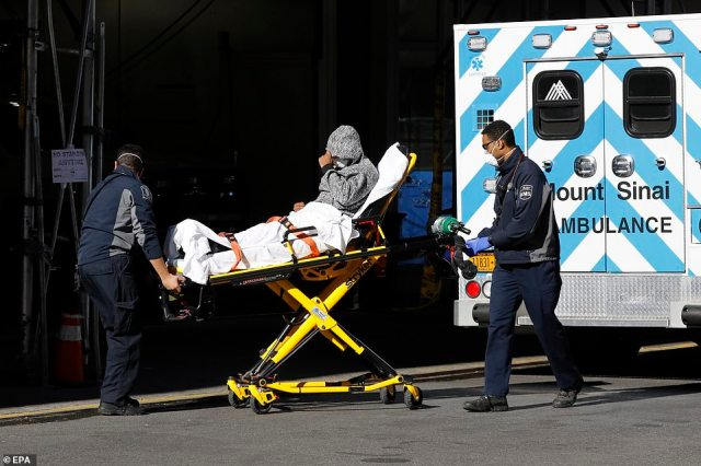 A patient is seen arriving at Mount Sinai West Hospital on Thursday