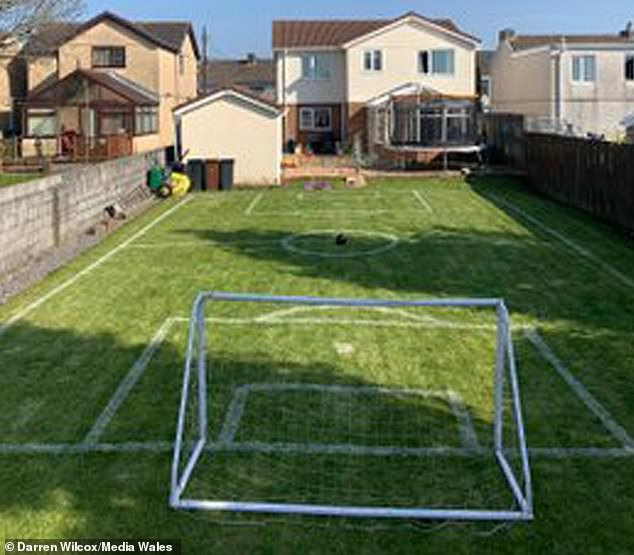 After about an hour and half, the 22m by 13m garden had been successfully turned into a football pitch fitted with its very own goal