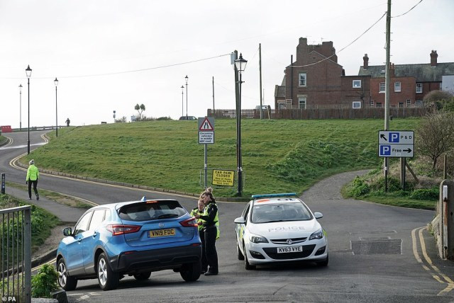 Police speak to drivers at Tynemouth beach, in the north-east of England close to Newcastle today