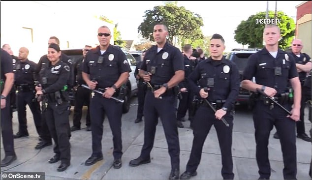 Law enforcement were forced to call for back up as the crowd became 'agitated'