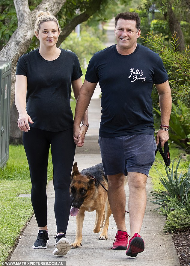 A breath of fresh air: Karl Stefanovic and his pregnant wife Jasmine Yarbrough enjoyed a breath of fresh air during a leisurely walk in Sydney on Tuesday, amid the coronavirus pandemic