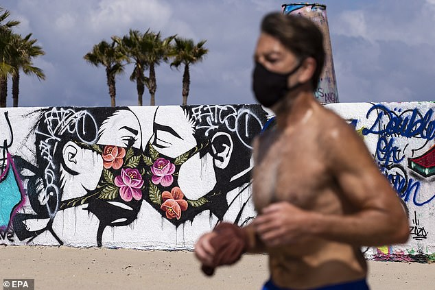 Research on how much protection face masks provides varies but, recently, experts are increasingly leaning toward the notion that something is better than nothing. A man wearing a face mask jogs in Venice Beach, California on Saturday