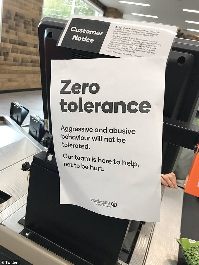 Woolworths posted signs around stores instructing shoppers not to abuse staff members