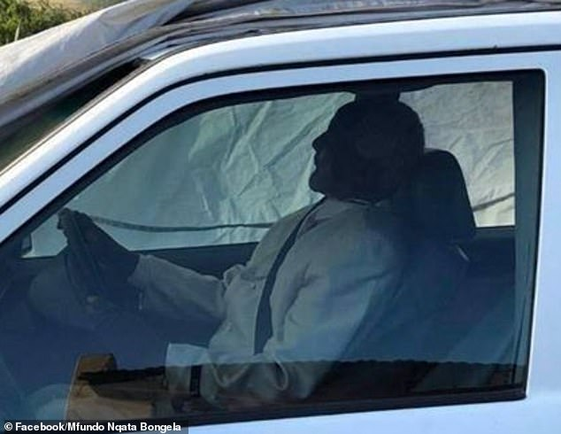 Traditional leader Tshekede Pitso seen here clasping the wheel in death. He asked that he be buried this way by officials, under direction of his family
