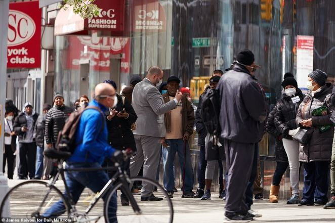 There were scores of people lining up at a bank in Harlem on Wednesday despite being warned to stay home and then keep a 6ft distance from people if they do have to go out