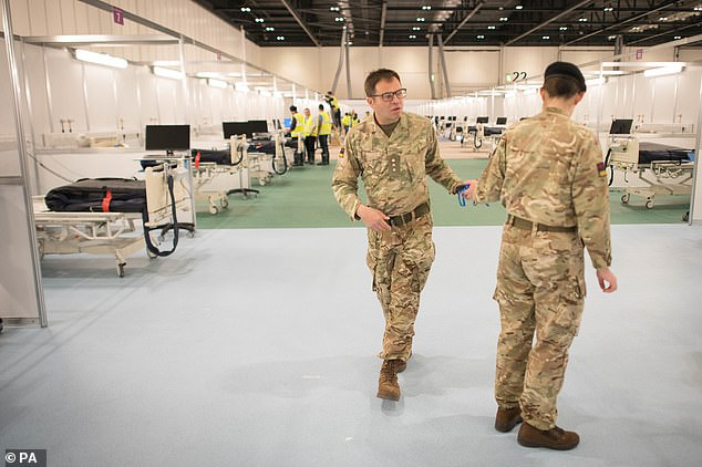 Up to 200 soldiers a day helped build the Docklands hospital. They carry out medical planning, logistics, engineering and tasks such as building beds, laying floors and carrying out electricity and plumbing (photo Tuesday)